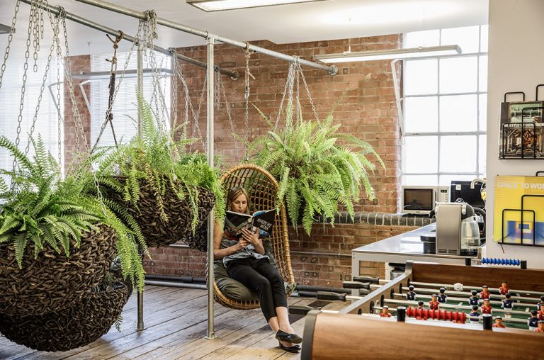 Cool office with employee relaxing